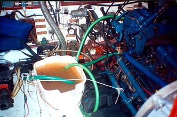 A spare bilge pump in the pail cools the diesel engine
